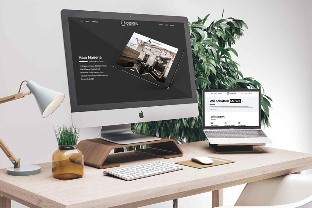Büro Schreibtisch mit Macbook und iMac